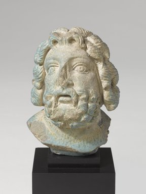 <em>Head from a Statuette of Zeus Serapis</em>, 1st century C.E. Faience, 3 7/8 x 2 7/8 x 2 3/8 in. (9.8 x 7.3 x 6 cm). Brooklyn Museum, Charles Edwin Wilbour Fund, 58.79.1. Creative Commons-BY (Photo: Brooklyn Museum, 58.79.1_PS9.jpg)