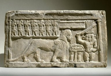 <em>Stela with Bes and Tutu</em>, 332-30 B.C.E. Limestone, 10 7/16 x 18 3/4 x 3 9/16 in., 47.4 lb. (26.5 x 47.7 x 9 cm, 21.5kg). Brooklyn Museum, Charles Edwin Wilbour Fund, 58.98. Creative Commons-BY (Photo: Brooklyn Museum, 58.98_SL1.jpg)