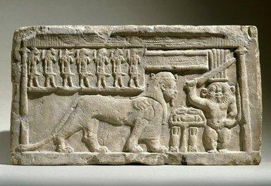 <em>Stela with Bes and Tutu</em>, 332-30 B.C.E. Limestone, 10 7/16 x 18 3/4 x 3 9/16 in., 47.4 lb. (26.5 x 47.7 x 9 cm, 21.5kg). Brooklyn Museum, Charles Edwin Wilbour Fund, 58.98. Creative Commons-BY (Photo: Brooklyn Museum, 58.98_SL1.jpg)