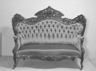 Joseph Meeks & Sons (1797-1868). <em>Three-seat Sofa (Rococo Revival style)</em>, ca. 1860. Rosewood veneer, bentwood, modern upholstery (reupholstered April 1960), 51 3/4 x 27 3/4 x 66 in. (131.4 x 70.5 x 167.6 cm). Brooklyn Museum, Gift of Mrs. Alfred Zoebisch, 59.143.26a. Creative Commons-BY (Photo: Brooklyn Museum, 59.143.26a_acetate_bw.jpg)
