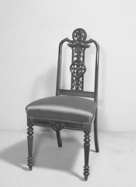 American. <em>Side Chair</em>, ca. 1858. Rosewood, modern upholstery, H: 37 in. (94 cm). Brooklyn Museum, Gift of Mrs. Alfred Zoebisch, 59.143.29. Creative Commons-BY (Photo: Brooklyn Museum, 59.143.29_acetate_bw.jpg)