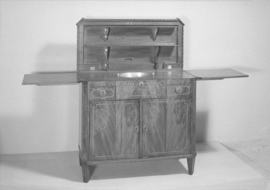 <em>Sideboard</em>, ca.1800. Mahogany veneer, Closed: 35 x 38 1/2 x 18 1/4 in. (88.9 x 97.8 x 46.4 cm). Brooklyn Museum, Gift of Mrs. Alfred Zoebisch, 59.143.31a-b. Creative Commons-BY (Photo: Brooklyn Museum, 59.143.31a-b_acetate_bw.jpg)