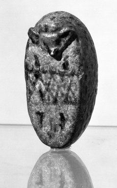 <em>Hedgehog Rattle</em>, ca. 1938-1700 B.C.E. Faience, 3 x 1 3/4 x 1 3/8 in. (7.6 x 4.4 x 3.5 cm). Brooklyn Museum, Charles Edwin Wilbour Fund, 59.186. Creative Commons-BY (Photo: Brooklyn Museum, 59.186_NegA_bw_SL4.jpg)