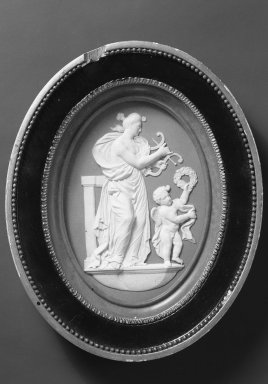 Wedgwood & Bentley (1768-1780). <em>Medallion of Terpsichore with Lyre and Gupid with Wreath</em>. White on blue jasperware Brooklyn Museum, Gift of Emily Winthrop Miles, 59.202.11. Creative Commons-BY (Photo: Brooklyn Museum, 59.202.11_view1_acetate_bw.jpg)