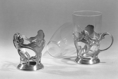 Wurttembergische Metallenwarenfabrik (1853-present). <em>Glass Holder</em>, ca. 1900. Silver, glass Brooklyn Museum, Gift of Jeanette Praeger, 59.203.1a-b. Creative Commons-BY (Photo: Brooklyn Museum, 59.203.1a-b_acetate_bw.jpg)