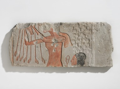 <em>Akhenaten and His Daughter Offering to the Aten</em>, ca. 1353-1336 B.C.E. Limestone, pigment, 8 15/16 × 20 5/16 × 1 1/4 in., 14.5 lb. (22.7 × 51.6 × 3.2 cm, 6.58kg). Brooklyn Museum, Charles Edwin Wilbour Fund