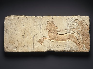 <em>Chariot</em>, ca. 1352-1336 B.C.E. Limestone, pigment (modern), 21 1/16 x 9 x 1 1/4 in.  (53.5 x 22.8 x 3.2 cm). Brooklyn Museum, Gift of New Hermes Foundation, 60.28. Creative Commons-BY (Photo: Brooklyn Museum, 60.28_SL1.jpg)