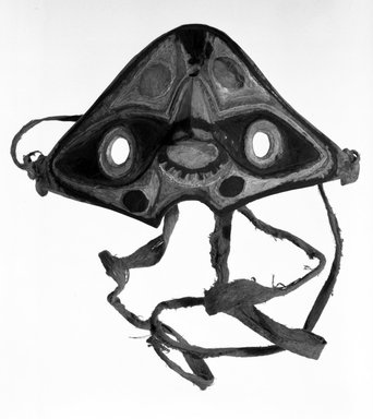 <em>Mask that Covers the Eyes and the Nose</em>, 20th century. Coconut shell, fiber string, pigment, 8 11/16 x 3 1/8 in. (22 x 8 cm). Brooklyn Museum, Gift of Ingeborg de Beausacq, 60.49.2. Creative Commons-BY (Photo: Brooklyn Museum, 60.49.2.jpg)