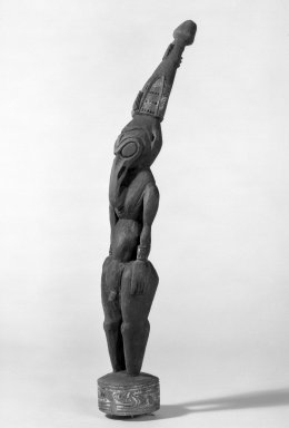 <em>Carved Human Figure</em>, 20th century. Wood, Height with base: 17 1/8 in. (43.5 cm). Brooklyn Museum, Museum Collection Fund, 60.52.9. Creative Commons-BY (Photo: Brooklyn Museum, 60.52.9_acetate_bw.jpg)