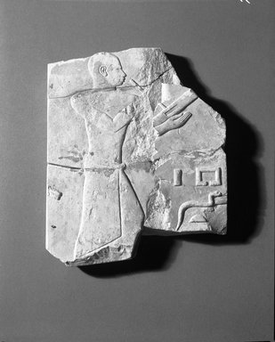 Egyptian. <em>Fragment of Relief</em>, ca. 727-712 B.C.E. Limestone, 7 5/16 x 6 3/16 in. (18.5 x 15.7 cm). Brooklyn Museum, Charles Edwin Wilbour Fund, 60.98. Creative Commons-BY (Photo: Brooklyn Museum, 60.98_NegA_film_bw_SL4.jpg)