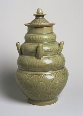 <em>Covered Funeral Vase</em>, 960-1127. High-fired green ware (celadon), 11 13/16 x 6 7/8 in. (30 x 17.4 cm). Brooklyn Museum, Gift from the collection of Edward A. Behr, 61.118.1. Creative Commons-BY (Photo: Brooklyn Museum, 61.118.1_SL1.jpg)