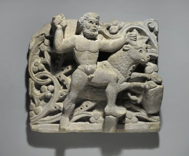 Coptic. <em>Heracles Smiting Acheloos in the Form of a Bull</em>, ca. 300-500 C.E. Limestone, 13 x 14 15/16 x 4 1/2 in. (33 x 38 x 11.5 cm). Brooklyn Museum, Charles Edwin Wilbour Fund, 61.128. Creative Commons-BY (Photo: Brooklyn Museum, 61.128_PS2.jpg)