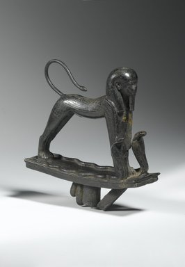 <em>Striding Sphinx</em>, ca. 945-712 B.C.E. Bronze, 5 1/2 x 1 5/8 x 5 in. (14 x 4.1 x 12.7 cm). Brooklyn Museum, Charles Edwin Wilbour Fund, 61.20. Creative Commons-BY (Photo: Brooklyn Museum, 61.20_threequarter_front_PS1.jpg)