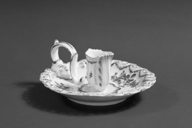 Worcester Royal Porcelain Co. (founded 1751). <em>Chamberstick</em>, ca. 1765. Porcelain, 2 1/4 x 6 1/4 in. (5.7 x 15.9 cm). Brooklyn Museum, Gift of Pearl and Donald S. Morrison, 61.232.11. Creative Commons-BY (Photo: Brooklyn Museum, 61.232.11_acetate_bw.jpg)