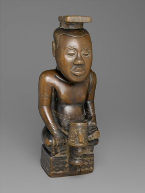 Kuba (Bushoong subgroup) artist. <em>Ndop figure depicting Nyim Mbó Mbóosh (r. ca. 1650), Nyim Mishé miShyááng máMbúl (r. ca. 1710), or Nyim Kot áNée (r. ca. 1740)</em>, ca. 1760-1780. Wood (Crossopteryx febrifuga), tukula, 19 1/2 x 7 5/8 x 8 5/8 in.  (49.5 x 19.4 x 21.9 cm). Brooklyn Museum, Purchased with funds given by Mr. and Mrs. Alastair B. Martin, Mrs. Donald M. Oenslager, Mr. and Mrs. Robert E. Blum, and the Mrs. Florence A. Blum Fund, 61.33. Creative Commons-BY (Photo: Brooklyn Museum, 61.33_PS2.jpg)