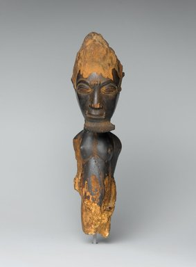 Baule. <em>Male Figure (Waka Sran)</em>, early 20th century. Wood, 11 x 3 9/16 x 4 1/4 in. (27.9 x 9 x 10.8 cm). Brooklyn Museum, Frank L. Babbott Fund, 61.3. Creative Commons-BY (Photo: Brooklyn Museum, 61.3_front_PS2.jpg)