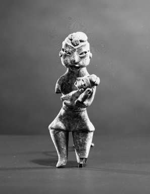 <em>Mother and Child Figurine</em>. Ceramic, pigment, 1 1/2 x 1 1/4 x 4 in. (3.8 x 3.2 x 10.2 cm). Brooklyn Museum, Museum Collection Fund, 61.88a. Creative Commons-BY (Photo: Brooklyn Museum, 61.88a_acetate_bw.jpg)