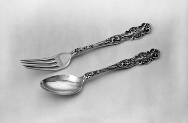 Tiffany & Company (American, founded 1853). <em>Spoon, Part of Child's Flatware Set</em>, ca. 1905. Sterling Silver, 1 1/8 x 5 1/2 in. (2.9 x 14 cm). Brooklyn Museum, Gift of Alfred M. F. Kiddle, 62.102.3b. Creative Commons-BY (Photo: , 62.102.3b_62.102.3c_acetate_bw.jpg)