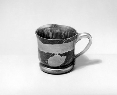 Tiffany Studios (1902-1932). <em>Mug</em>, ca. 1900. Opalescent glass, 3 1/8 x 5 x 3 5/8 in. (7.9 x 12.7 x 9.2 cm). Brooklyn Museum, Gift of Alfred M. F. Kiddle, 62.102.5. Creative Commons-BY (Photo: Brooklyn Museum, 62.102.5_bw.jpg)