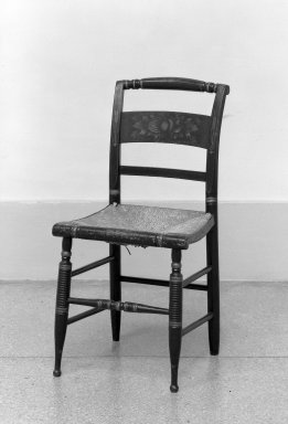 American. <em>Sheraton Side Chair, One of Set</em>, ca.1820. Rush, painted wood, 33 1/2 x 17 in. (85.1 x 43.2 cm). Brooklyn Museum, Dick S. Ramsay Fund, 62.105.1. Creative Commons-BY (Photo: Brooklyn Museum, 62.105.1_acetate_bw.jpg)