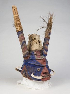 Tomman Islander. <em>Headdress</em>, early 20th century. Bamboo, leaves, vegetal-fiber paste, tusks, pigment, 20 3/4 x 19 1/2 x 21 in. (52.7 x 49.5 x 53.3 cm). Brooklyn Museum, Frank L. Babbott Fund, 62.18.4. Creative Commons-BY (Photo: , 62.18.4_threequarter_PS11.jpg)
