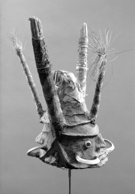 Tomman Islander. <em>Headdress</em>, early 20th century. Bamboo, leaves, vegetal-fiber paste, tusks, pigment, 20 3/4 x 19 1/2 x 21 in. (52.7 x 49.5 x 53.3 cm). Brooklyn Museum, Frank L. Babbott Fund, 62.18.4. Creative Commons-BY (Photo: Brooklyn Museum, 62.18.4_threequarter_acetate_bw.jpg)