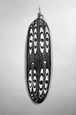 <em>Shield</em>, early to mid-20th century. Wood, pigment, 31 1/2 x 9 1/16 in. (80 x 23 cm). Brooklyn Museum, Gift of Stanley Ross, 62.55.9. Creative Commons-BY (Photo: Brooklyn Museum, 62.55.9_acetate_bw.jpg)