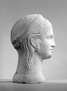 Etruscan. <em>Half-Head of a Goddess (probably)</em>, ca. 100-50 B.C.E. Terracotta, 11 1/8 × 7 1/2 × 3 9/16 in. (28.2 × 19 × 9 cm). Brooklyn Museum, Museum Collection Fund, 62.66. Creative Commons-BY (Photo: Brooklyn Museum, 62.66_acetate_bw.jpg)