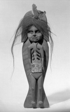 Tlingit. <em>Shaman's Doll Riding on the Back of a Killer Whale</em>, 1834-1867. Red cedar, pigment, leather, human hair, feathers, 16 9/16 x 4 3/4 in.  (42 x 12 cm). Brooklyn Museum, Frank L. Babbott Fund, 62.82. Creative Commons-BY (Photo: Brooklyn Museum, 62.82_acetate_bw.jpg)