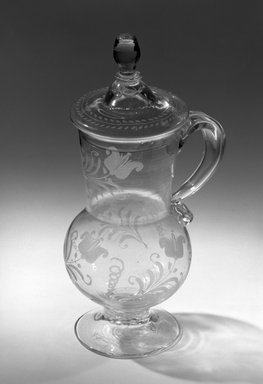Stiegel. <em>Tankard with Cover</em>, ca. 18th century. Clear flint glass Brooklyn Museum, Gift of Henry Bradley Martin, 63.144a-b. Creative Commons-BY (Photo: Brooklyn Museum, 63.144_acetate_bw.jpg)