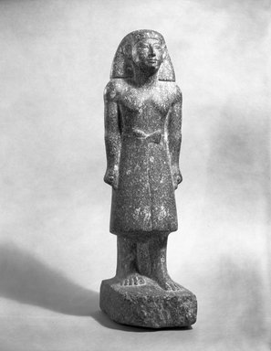 <em>Statue of Standing Man</em>. Granite, 17 1/2 in. (44.5 cm). Brooklyn Museum, Anonymous gift, 63.89. Creative Commons-BY (Photo: Brooklyn Museum, 63.89_film_bw.jpg)