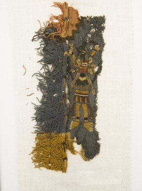 Nazca. <em>Textile Fragment, Border</em>, 200-600 C.E. Cotton, camelid fiber, 8 1/4 x 3 15/16 in. (21.0 x 10.0 cm) (including weft fringe). Brooklyn Museum, Gift of Adelaide Goan, 64.114.14 (Photo: Brooklyn Museum, 64.114.14_front_PS5.jpg)