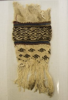 <em>Loincloth (probably), Tie, Fragment</em>, 1532-1700 or 1000-1400. Cotton, camelid fiber, 3 9/16 x 9 1/16 in. (9 x 23 cm). Brooklyn Museum, Gift of Adelaide Goan, 64.114.210 (Photo: Brooklyn Museum, 64.114.210_front_PS5.jpg)