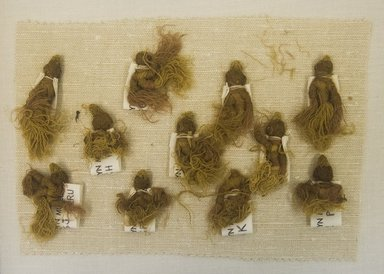 Chancay. <em>11 Tassels, Fragments</em>, 1000-1532. Camelid fiber, 2 3/8 x 13/16in. (6 x 2cm). Brooklyn Museum, Gift of Adelaide Goan, 64.114.65a-k (Photo: Brooklyn Museum, 64.114.65a-k_front_PS5.jpg)