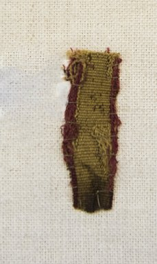 Inca/Moquegua. <em>Textile Fragment, undetermined</em>. Cotton, camelid fiber, 11/16 x 2 in. (1.8 x 5.1 cm). Brooklyn Museum, Gift of Adelaide Goan, 64.114.75.2 (Photo: Brooklyn Museum, 64.114.75.2_front_PS5.jpg)