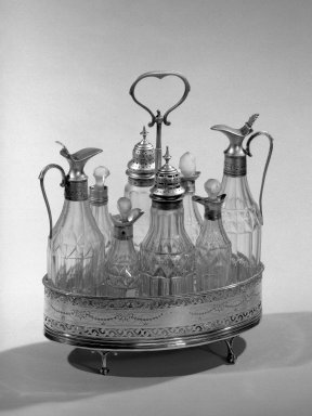 Hester Bateman (English, active in London, 1774-1789). <em>Set of Casters on Stand</em>, ca.1790. Silver, 10 1/2 in. (26.7 cm). Brooklyn Museum, Gift of Mr. and Mrs. Frederick B. Hicks, 64.152.10a-k. Creative Commons-BY (Photo: Brooklyn Museum, 64.152.10_acetate_bw.jpg)