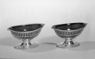 Hester Bateman (English, active in London, 1774-1789). <em>Salts, One of Pair</em>, ca. 1788-1789. Silver, glass, 2 1/8 x 2 3/4 x 4 in. (5.4 x 7 x 10.2 cm). Brooklyn Museum, Gift of Mr. and Mrs. Frederick B. Hicks, 64.152.15a-b. Creative Commons-BY (Photo: Brooklyn Museum, 64.152.15a-b_acetate_bw.jpg)