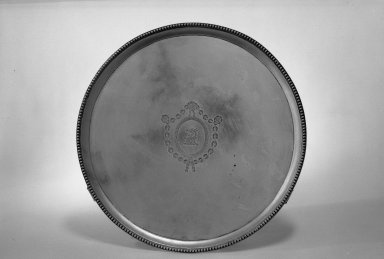 Hester Bateman (English, active in London, 1774-1789). <em>Tray</em>, ca. 1789-1790. Silver, 1 1/8 x 13 1/8 in. (2.9 x 33.3 cm). Brooklyn Museum, Gift of Mr. and Mrs. Frederick B. Hicks, 64.152.27. Creative Commons-BY (Photo: Brooklyn Museum, 64.152.27_acetate_bw.jpg)