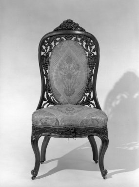 John Henry Belter (American, born Germany, 1804-1863). <em>Side Chair (one of a pair with 64.153.2)</em>, ca. 1855. Rosewood, modern upholstery, 38 1/2 in. (97.8 cm). Brooklyn Museum, Gift of Mrs. Charles S. Jenney, 64.153.1. Creative Commons-BY (Photo: Brooklyn Museum, 64.153.1_acetate_bw.jpg)