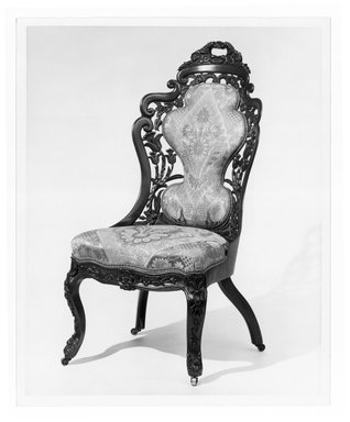 Attributed to John Henry Belter (American, born Germany, 1804-1863). <em>Side Chair (one of a pair with 64.153.1)</em>, ca. 1855. Rosewood, modern upholstery, 38 1/2 in. (97.8 cm). Brooklyn Museum, Gift of Mrs. Charles S. Jenney, 64.153.2. Creative Commons-BY (Photo: Brooklyn Museum, 64.153.2_print_bw_SL1.jpg)