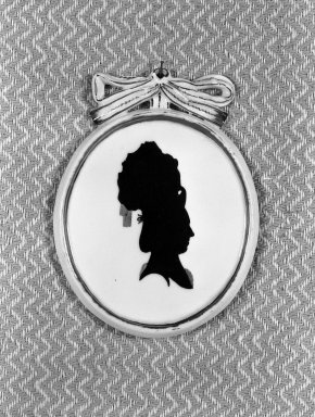<em>Silhouette: Bust of Woman With Tall Coiffure Facing Right</em>, ca. 1790. Paint on porcelain, ribbon hanger, 2 7/8 x 3 7/8 in. (7.3 x 9.8 cm). Brooklyn Museum, Gift of the Estate of Emily Winthrop Miles, 64.195.87 (Photo: Brooklyn Museum, 64.195.87_acetate_bw.jpg)