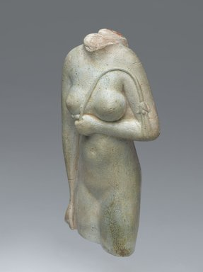 <em>Woman Holding a Lily Scepter</em>, 305-30 B.C. Faience, 4 3/16 x 2 1/16 in. (10.6 x 5.2 cm). Brooklyn Museum, Charles Edwin Wilbour Fund, 64.198. Creative Commons-BY (Photo: Brooklyn Museum, 64.198_threequarter_left_PS2.jpg)