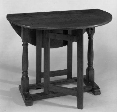 American. <em>Drop Leaf Table with Trestle Legs and Straight Gates</em>, ca. 1690. Cherry wood Brooklyn Museum, Gift of Jerome Blum, 64.201. Creative Commons-BY (Photo: Brooklyn Museum, 64.201_bw.jpg)