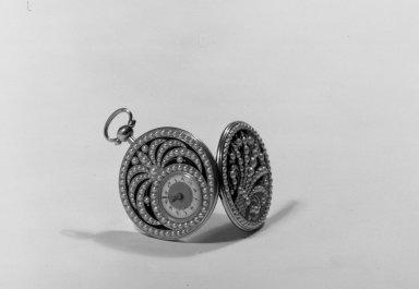<em>Watch</em>, ca. 1825. Gold, enamel, half-pearls, 1 7/8 x 1 3/8 in. (4.8 x 3.5 cm). Brooklyn Museum, Anonymous gift, 64.241.21. Creative Commons-BY (Photo: Brooklyn Museum, 64.241.21_acetate_bw.jpg)