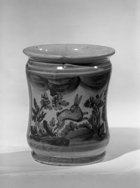 Delft. <em>Drug Pot, One of a Set</em>, ca. 1714. Tin-enamelled earthenware, 5 3/4 x 4 1/2 in. (14.6 x 11.4 cm). Brooklyn Museum, Anonymous gift, 64.241.54. Creative Commons-BY (Photo: Brooklyn Museum, 64.241.54_acetate_bw.jpg)