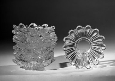 <em>Set of Bobeches</em>, ca. 1900. Pressed colorless glass., 7/8 x 3 3/8 in. (2.2 x 8.6 cm). Brooklyn Museum, Anonymous gift, 64.241.87a-i. Creative Commons-BY (Photo: Brooklyn Museum, 64.241.87a-l_acetate_bw.jpg)