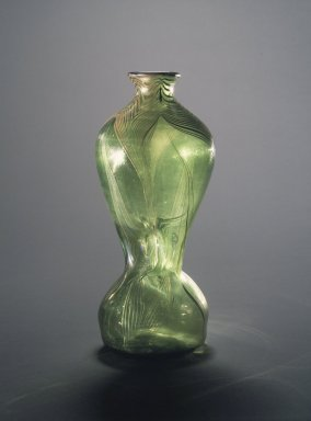 Louis Comfort Tiffany (American, 1848-1933). <em>Vase</em>, ca. 1900. Green glass, 10 x 3 1/4 in. (25.4 x 8.3 cm). Brooklyn Museum, Gift of Mrs. Anthony Tamburro in memory of her father, Rene de Quelin, 64.246.7. Creative Commons-BY (Photo: Brooklyn Museum, 64.246.7.jpg)