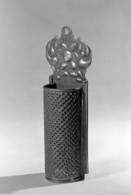 <em>Grater</em>, ca. 1675. Brass, 2 3/4 x 8 1/2 in. (7 x 21.6 cm). Brooklyn Museum, Purchased with funds given by anonymous donors, 64.3.7. Creative Commons-BY (Photo: Brooklyn Museum, 64.3.7_acetate_bw.jpg)