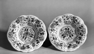 <em>Plates</em>, ca. 1650. Delft, 1 3/4 x 8 1/2 in. (4.4 x 21.6 cm). Brooklyn Museum, Purchased with funds given by anonymous donors, 64.46.1a-b. Creative Commons-BY (Photo: Brooklyn Museum, 64.46.1a-b_acetate_bw.jpg)