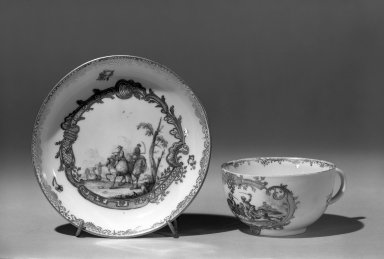 Meissen Porcelain Factory (German, founded 1710). <em>Cup and Saucer                                                  Violet/gold</em>, ca.1770. Porcelain, Cup: 1 3/4 x 3 1/16 in. (4.4 x 7.8 cm). Brooklyn Museum, Gift of the Estate of Emily Winthrop Miles, 64.82.129a-b. Creative Commons-BY (Photo: Brooklyn Museum, 64.82.129a-b_acetate_bw.jpg)